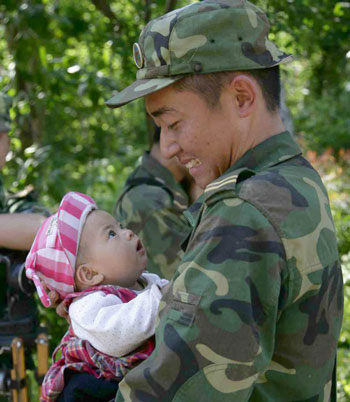 a Chinese soldier and a baby - The man is a Chinese soldier,he went to help people,he saved a baby,but the baby's mother died.