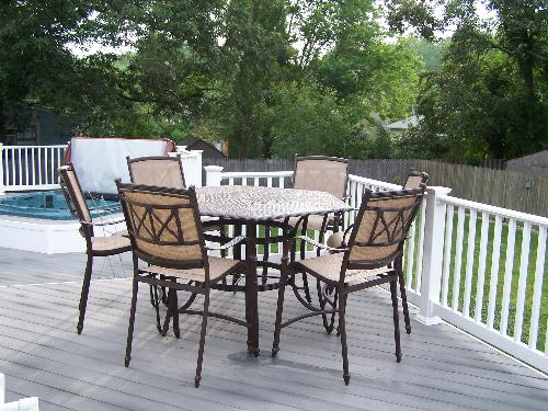 Deck furniture - Seats 6 and has an opening for an umbrella.