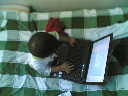 Thats my kid working on his fathers laptop - When we were small we dint even know how a computer looked and to see my two year old trying to do what we do at the computer....... The world is moving fast.