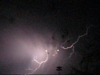 Lightning in night sky - A bolt of lightning in the night sky.
