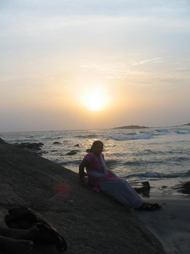 kovalam beach  - this is a sunset photo of me sitting on a big rock just below the light house.