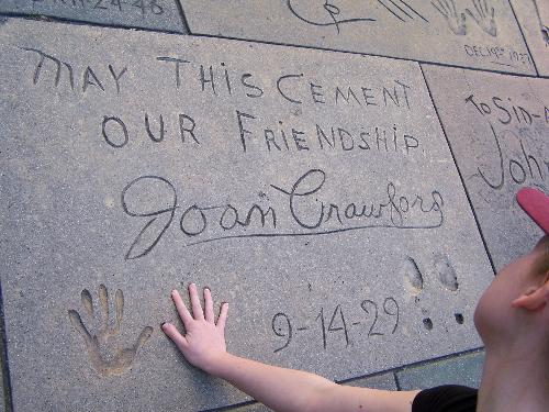 Me playing with Joan Crawford's handprints in Holl - Joan Crawford's square at the Graumann's Chinese Theater on Hollywood Boulevard