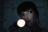 in the dark - woman holding flash light when power goes out