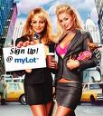 """Royalty or just plain Loyalty - Picture of Paris Hilton and Nicole Richie in The Simple Life garb in the city holding up paper that says """"Sign up, at Mylot"""", Paris on the right, Nicole holding the sign on the left."""