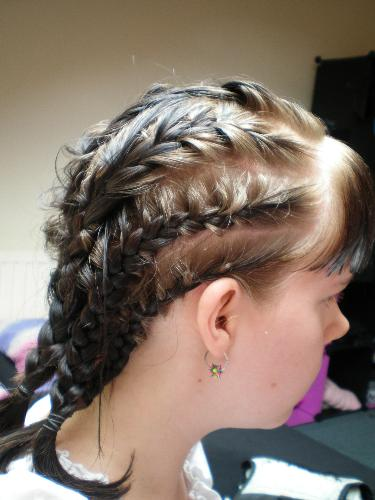 Braids - I did these braids on myself which is a lot harder and I hadn't a spare mirror so it was basicly just a guess what section I was braiding. This was a very early attempt at cornrowing my own hair last year in june. I have a crown braid today of which I can post pics later [em]wink[/em].