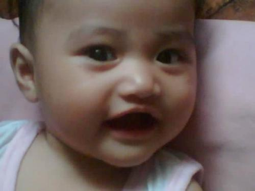 baby girl pauleen - our baby girl pauleen with a big smile in her face