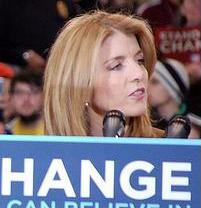 Caroline Kennedy - Caroline Kennedy behind a podium that has a Change sign in front of it.