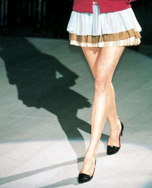 miniskirt - Image of woman wearing a miniskirt. Lower part of body only.