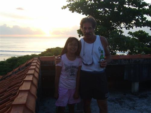 me and mr. Mink - We were standing at my favorite spot to watch the sunset. Kryssy make this picture for me. Isn't she nice? Mink likes to surf the wafe. And the roof is perfect for see all the wave at Kuta beach Bali.