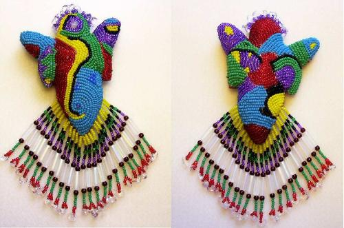 Spirit Doll - This is a muslin doll stuffed with cotton batting. The surface is completely covered with bead embroidery in various colors, sizes, textures and patterns.