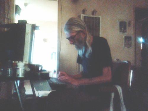 Hard at work - Me typing away, updating my blog.