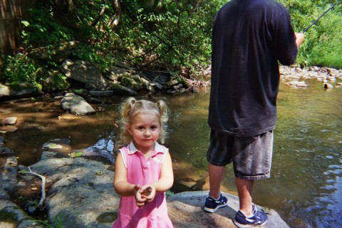 Kiana - Kiana fishing for the first time with daddy. God I love this picture. She was so proud of her little fish. Her and dad took it and let it lose in the pond in my grandparents back yard.