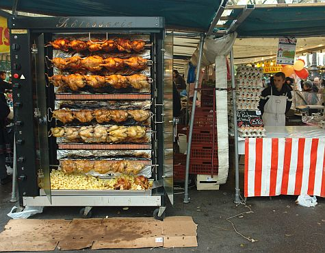 French rotisserie - Chickens cooking in a French market.