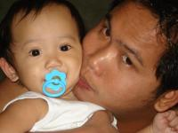 mu husband - this is a picture of my husband with my baby boy...:))