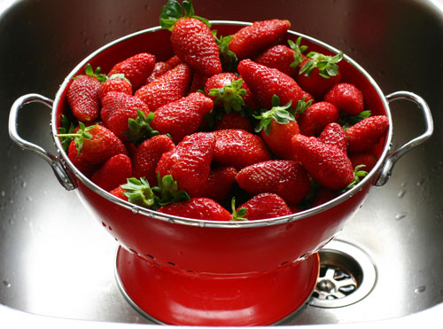 strawberry - this is a picture of strawberries. strawberries are small sweet red fruit containing many achenes resembling seeds. it may also refer to a plant that spreads by means of rooting stems and bears strawberries. it is very delicious. try some