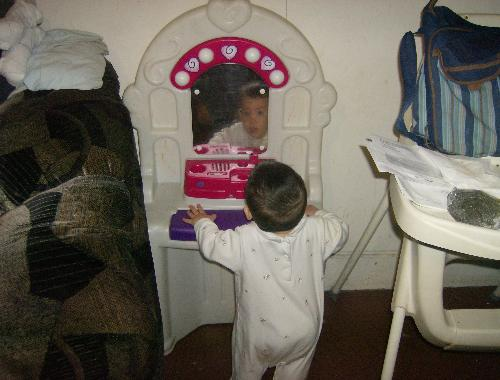 Who's that gorgeous boy in the mirror? - My son staring at himself in the mirror