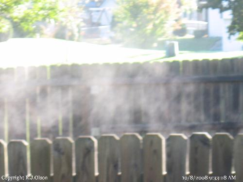 Steamy Morning - Steam from the cool air and warm sun beaming on the dew in Minnesota.