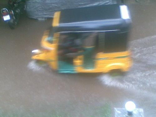 Water logging in the streets - An auto rickshaw wading through a water logged street in Anna Nagar in Chennai