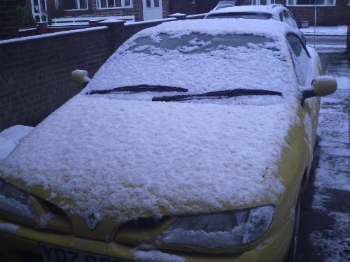 my yellow car - had a snow this morning, so it covered with snow.