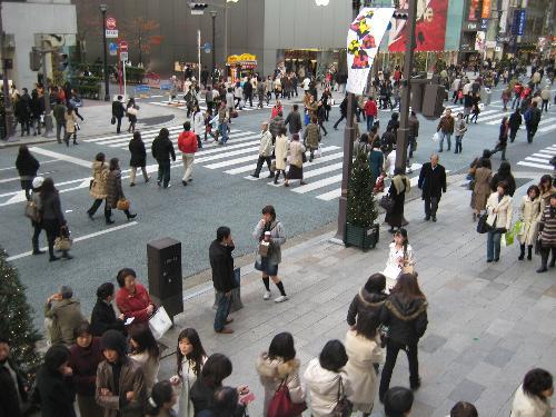People walking at Ginza Tokyo Japan - Many people walking on the street at Ginza Tokyo Japan