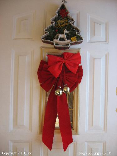 Front Door - Bows and Jingle Bells for the Holiday Season.