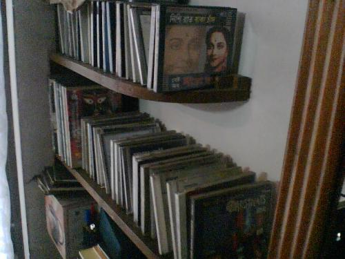 Shelf of CD,VCD & DVD - Now our shelf is full of CD,VCD and VCDs,no books.