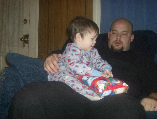 Baby's first Gift - My youngest with his dad opening a gift for Christmas