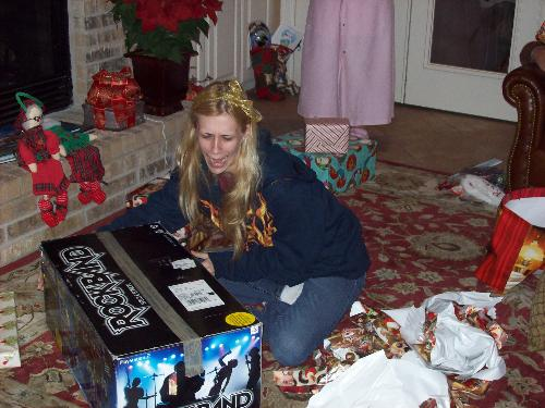 Christmas morning - The look on my daughters face Christmas morning was priceless when she found out she got the Rock Band game she had been wanting for months. What more could a mother ask for?
