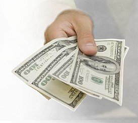 what i hope to have by writing articles - money, a hand extended out holding several large american currency bills
