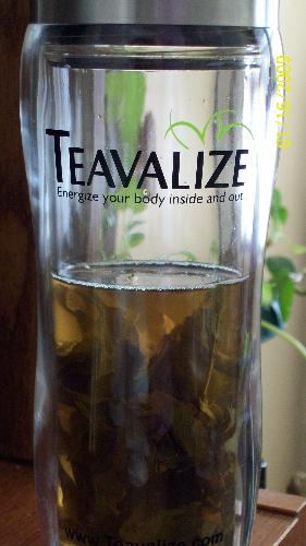 My slenderizing tea  - A picture of the Teavalize diffuser and the cool tea leafs floating around inside.