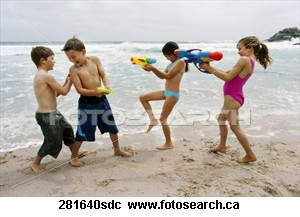Enjoy life and have fun - Children playing on the beach, well laughing and having fun.