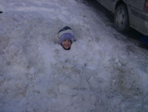 Buried in the snow - My daughter, buried in the snow