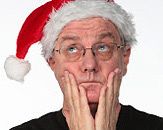 Stressful Christmas - Man stressed man is waiting for Christmas. He wears a red Santa hat.