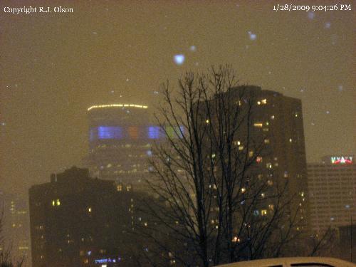 Minneapolis Skyline - A shot of Downtown Minneapolis Minnesota on a Januray night snowstorm.