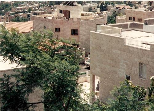 Solar Hot Water heating units in Jerusalem, Israel - This picture shows the typical solar hot water heaters that are in use in Israel. They heat the water for use in residential apartments. It saves a lot on the cost of heating water for household use.