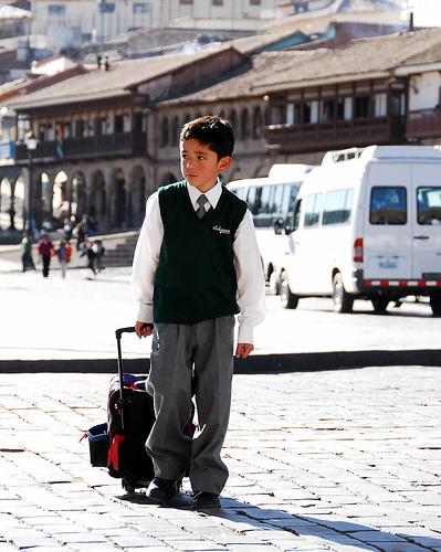 school boy - a boy in his uniform with his rolling bag
