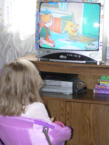 my daughter watching martha speaks - This is a picture of my daughter when she was watching Martha Speaks on pbs this morning. She loves this show and I do to!