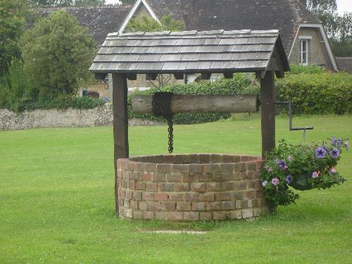 The Reconstructed Well - This is believed to be an old Saxon well which was uncovered whilst digging the foundations for the new cricket pavilion. It's 90 feet deep but a false metal bottom has been inserted close to the top, to save accidents.