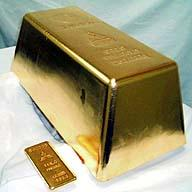 gold bar,money - The Mitsubishi Materials Corporation of Japan poured the World's largest Gold bar. The bar is 17.9 inches by 8.9 inches and 6.7 inches high. All though it takes up the same amount of space as a large shoe box, you would not be able to lift it as It weighs 551.15 pounds. At the time it was poured it was worth $3.7 million.