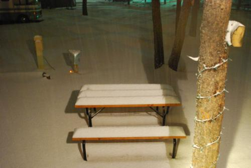 Picnic table in the snow - Photo was taken on 04/16/2009, in Woodland park, Colorado 8500 feet above sea level in the Pikes Peak mountains. Photo taken at about 9:00pm, it had been snowing for about 4 hours at this point, and was already around 6 inches deep or better! Expected snow fall is between 24 and 36 inches! As of the writting of this, (12:00 pm, 04/17/2009, we have about 12 inches or so on the ground, and the snow is still falling!  This is our second Colorado winter, and the reason we moved to the mountains was because God called us up here, and we wanted feet of snow! We finally are getting our feet of snow, and I am going photo crazy!!!