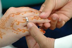 wedding ritual - the bridegroom slids our wedding ring on to me