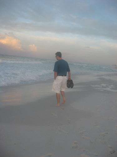 my husband on the beach - walking on the beach at sunrise