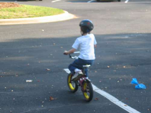 Boy riding a bike for the first time - Bike riding minus training wheels