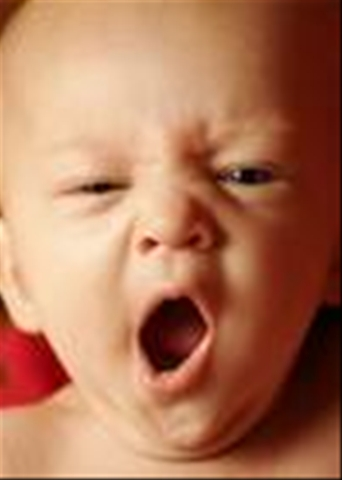 A child yawnning - THIS is a cute picture of a child yawning.the child is about the some months old and the yawnig it quite funny.