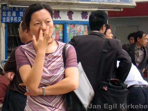 pinking nose  - a woman picking her nose