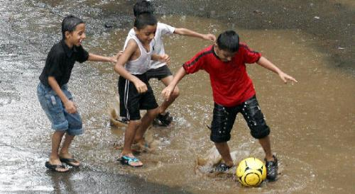 Playing in rains!!!!!!!! - These kids rocks!!!!!!!!!I would like to be one of them.
