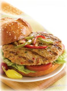 chicken burger - chicken burger on a white bun with veggies