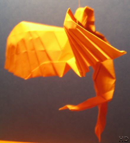 An Angel - An orange angel flying in the air - made by paper.