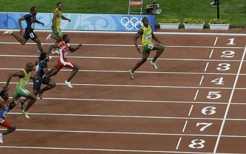 Lightning Usain Bolt - The King of Sprints, at his blitz in the Beijing Olympics 2008. Note the loose shoe lace and that glance.