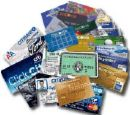 credit cards - Photo of different kinds of credit cards laying in a big pile.